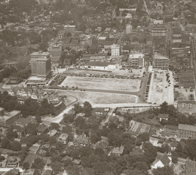 an historic aerial photo of Battery Park in downtown asheville before the construction of the Grove Arcade in the 1920s