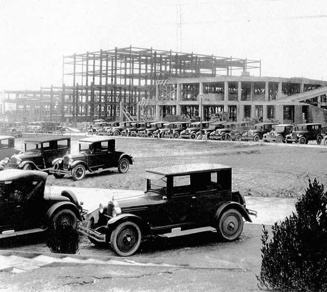 a historic black and white photo from the 1920s of the construction of the Grove Arcade