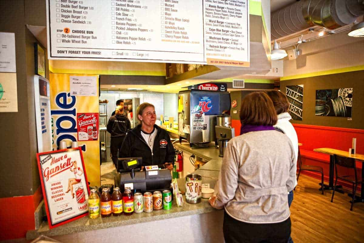 Two women ordering food at the register at Burgerworx