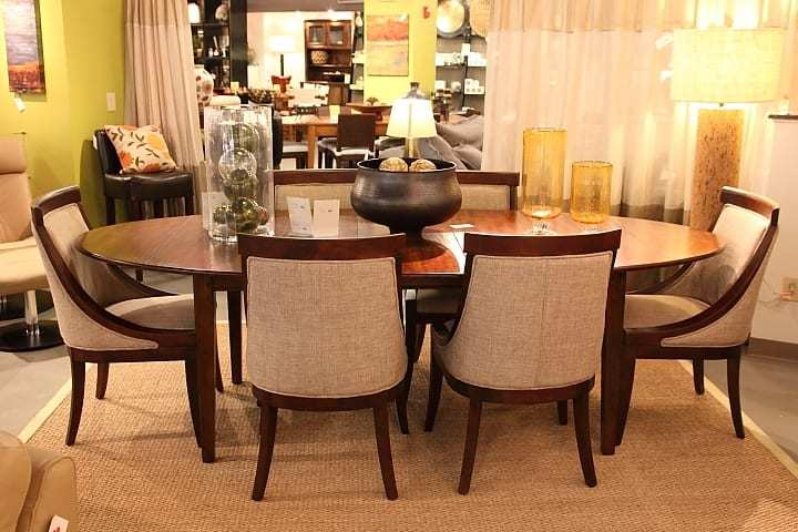 a designer wooden table on display in a furniture store