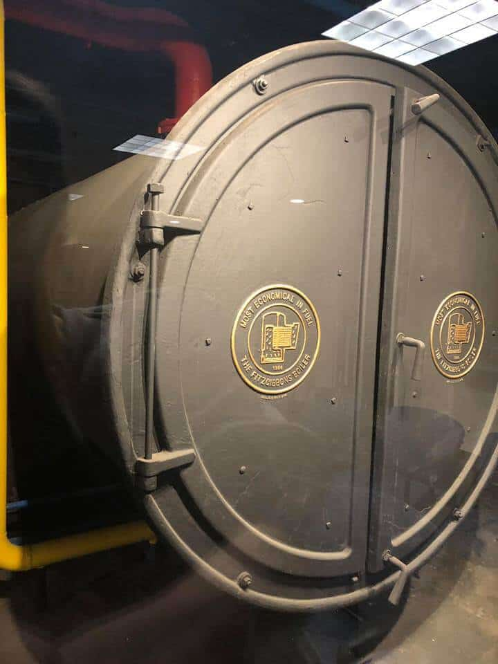 photo of the one of the large grey boilers in the boiler room of Grove Arcade