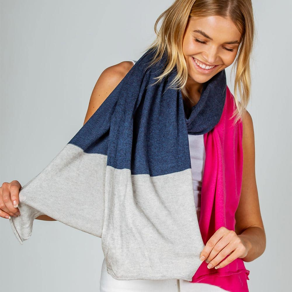 woman wearing spring scarf from caravans clothing store