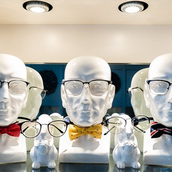 mannequin heads wearing fine eyeglasses at the eye center