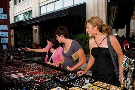 browsing treasures at makers market in downtown asheville