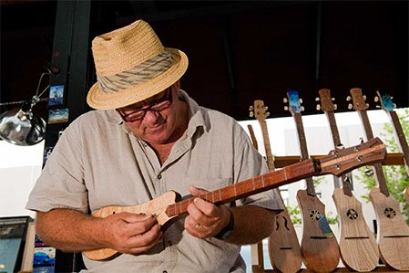 playing a woodrow instrument at makers market in downtown asheville